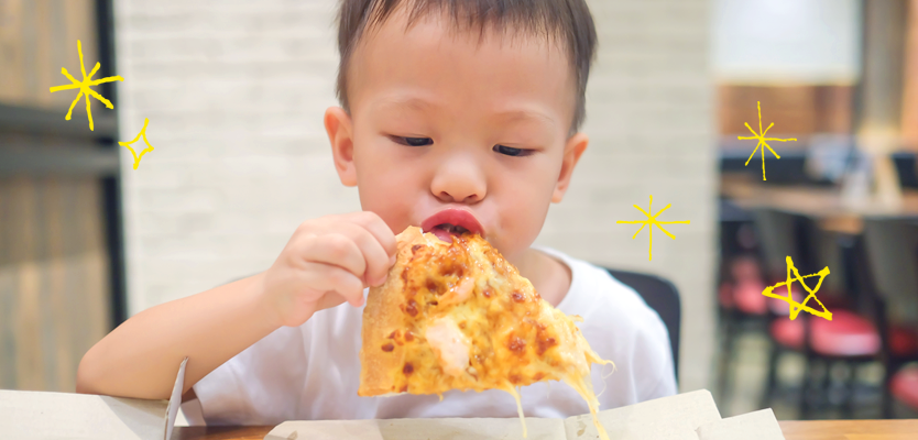 baby eating pizza